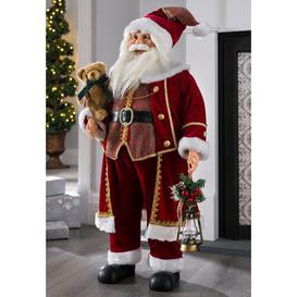image-Standing Santa Christmas Figurine Three Posts