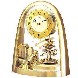 image-Rhythm Gold Rotating Pendulum Mantel Clock - Space