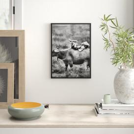 image-Water Buffalo Carrying Child Framed Graphic Art Print East Urban Home Size: 100 cm H x 70cm W