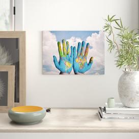 image-'Globe Hands World Map' Graphic Art East Urban Home Size: 42 x 59.4cm