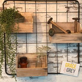 image-Metal wall hanging frame and wooden storage boxes