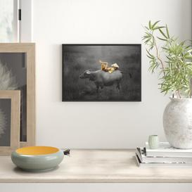 image-Child Lying on Water Buffalo Framed Photographic Art Print East Urban Home Size: 70cm H x 100cm W